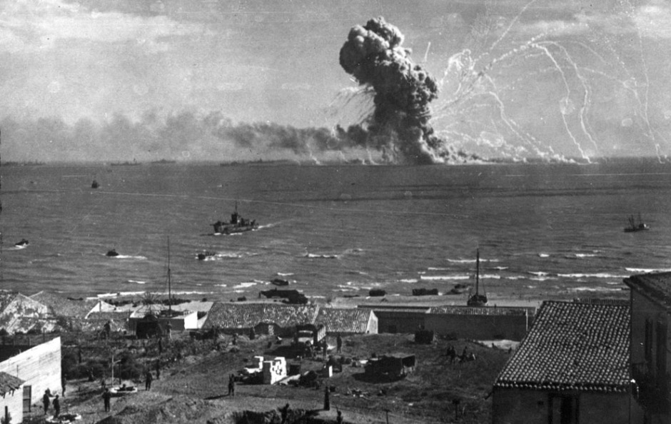 During the invasion of Sicily by Allied forces, an American cargo ship, loaded with ammunition, explodes after being hit by a bomb from a German plane off Gela, on the southern coast of Sicily, on July 31, 1943. (AP Photo)