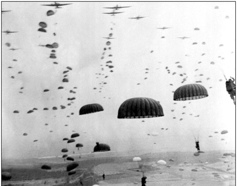 Parachutes open as waves of paratroops land in Holland during operations by the 1st Allied Airborne Army in September of 1944. Operation Market Garden was the largest airborne operation in history, with some 15,000 troops were landing by glider and another 20,000 by parachute.